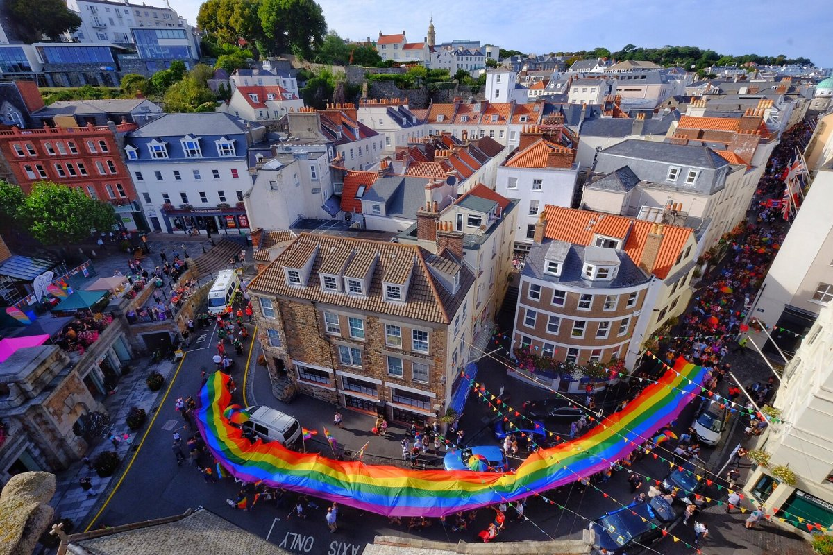 Photo: C I Pride parade in Guernsey from the top of the town church
