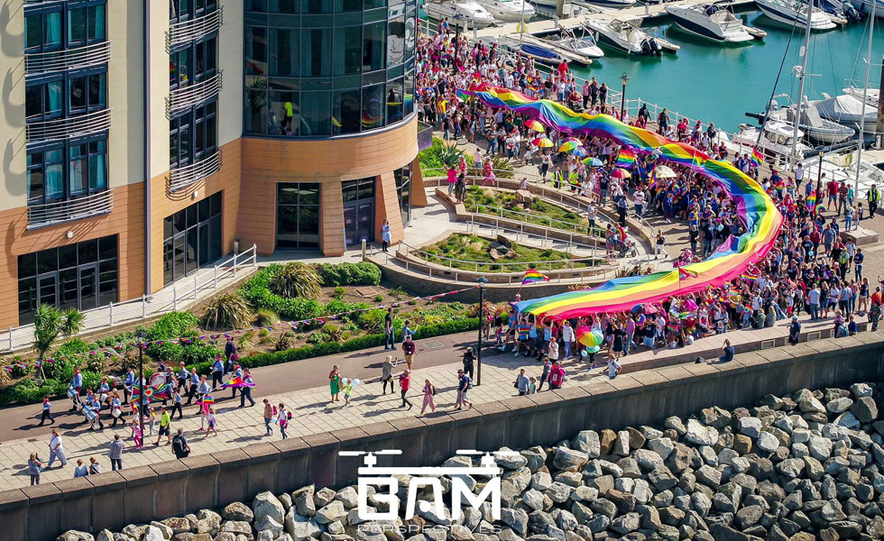 Photo: C I Pride parade rounding the corner of the Radisson Hotel, taken from the air
