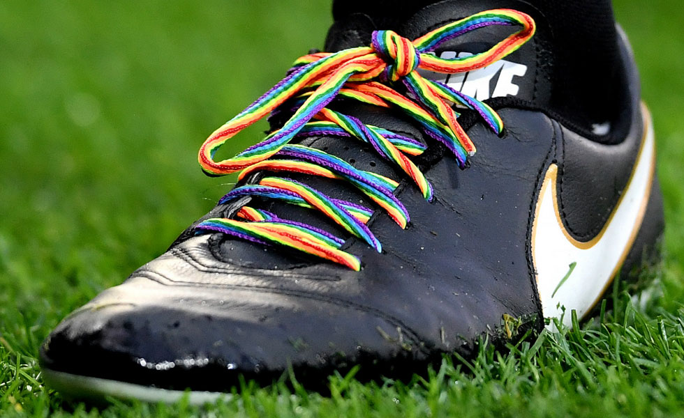 Photo: a football boot with rainbow laces